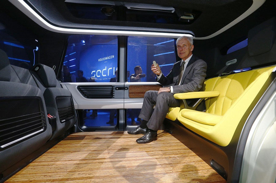 Volkswagen CEO Mueller presents Sedric concept car during Volkswagen event ahead of the 87th International Motor Show at Palexpo in Geneva